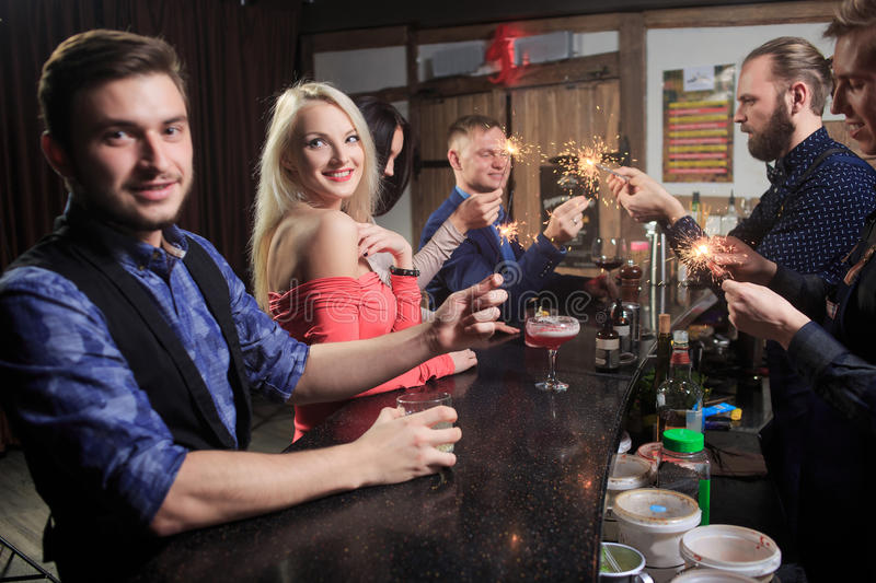 People in the bar. night club. sparklers stock photos