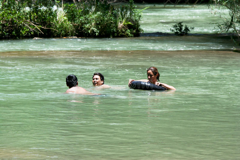People bathing and swimming. Agua Azul waterfalls royalty free stock image