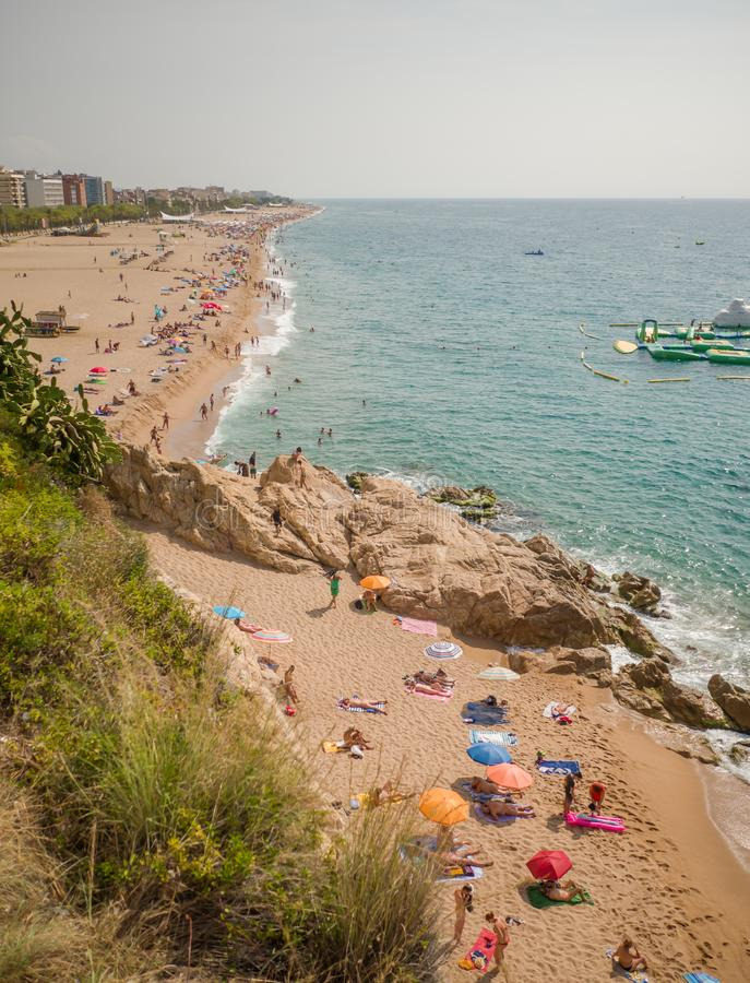 People at beach in Calella city. Spain. stock photography