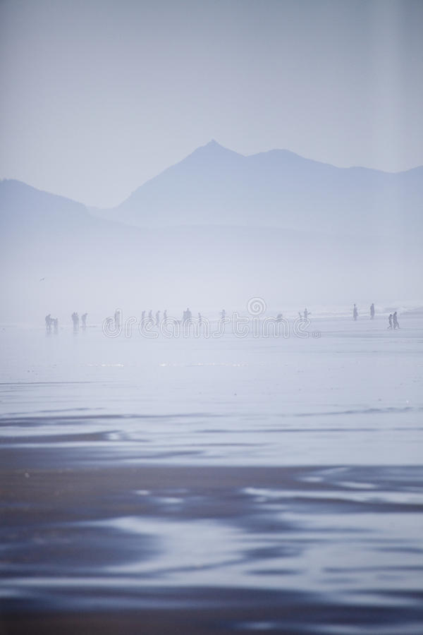 People on the Beach in the Fog royalty free stock photography