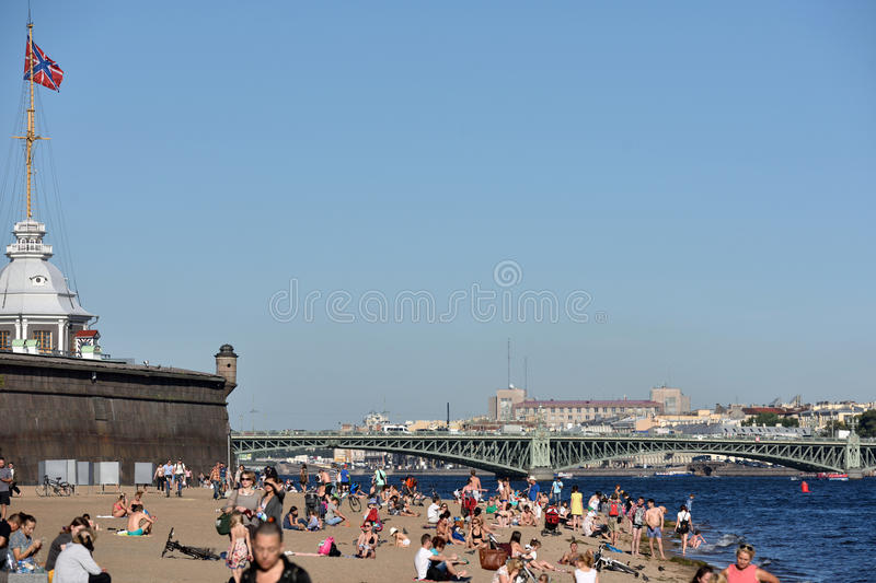 People on the beach in St. Petersburg, Russia royalty free stock photo