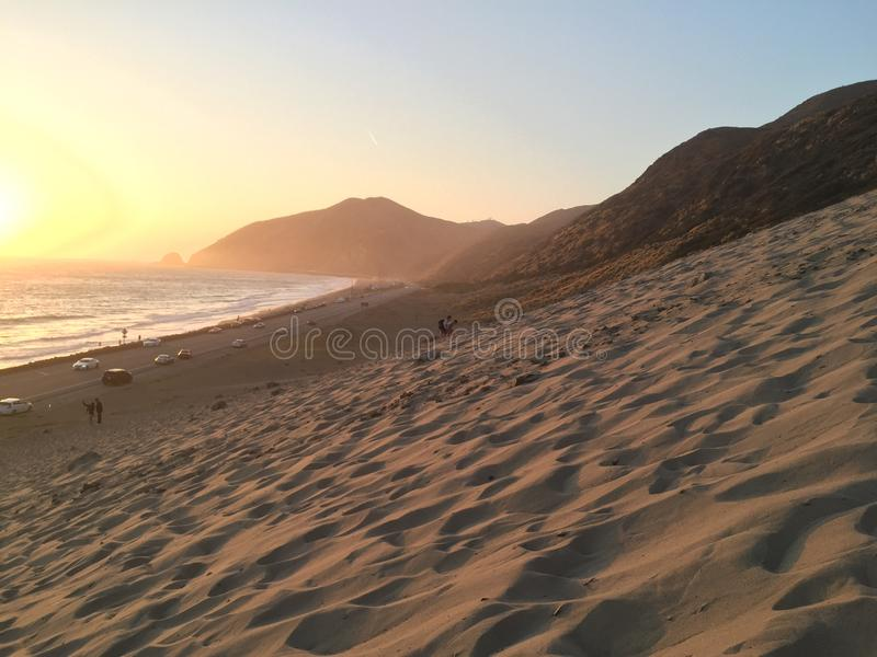 People on the beach at sunset in southern California royalty free stock image