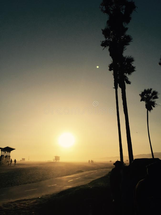 People on the beach at sunset in southern California stock image