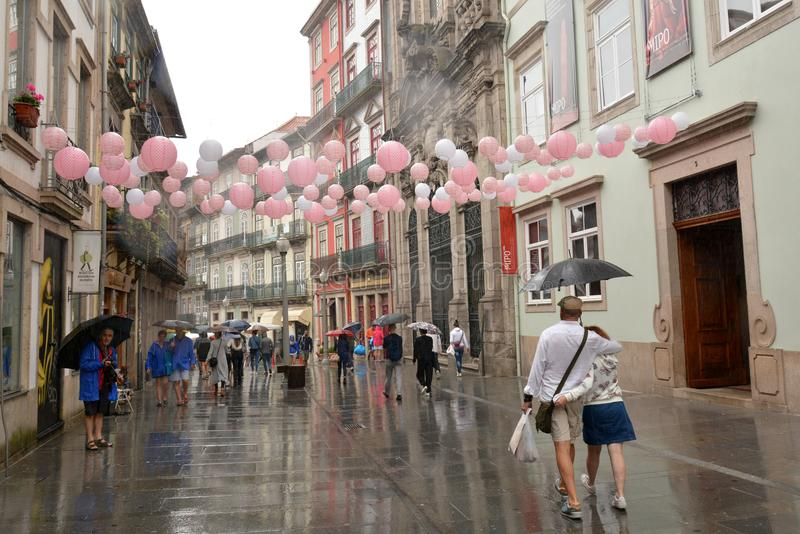 People on a beautiful street of flowers in the center. royalty free stock photos