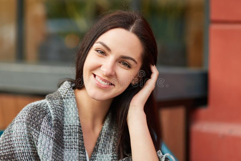 People, beauty, emotions and lifestyle concept. Close up portrait of brunette female with appealing look, enjoys calm peaceful atm stock images