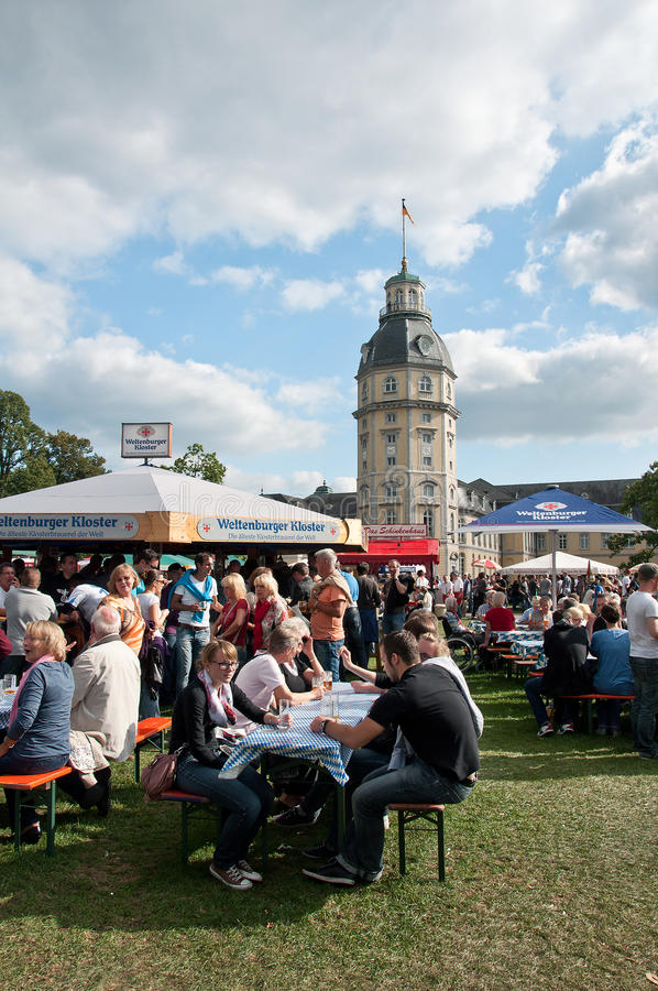 People by beer festival, Karlsruhe, Germany. Hundreds of beers from Europe were served in Schlossgarten in Karlsruhe stock image