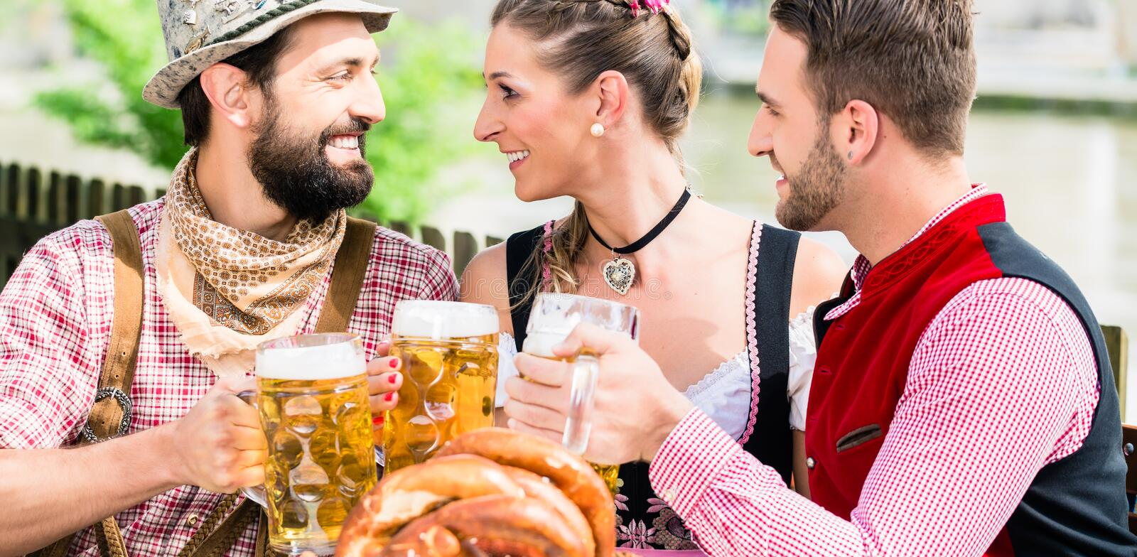 People with beer and pretzel in Bavaian inn stock image