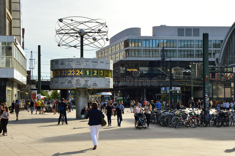 People in Berlin`s Alexanderplatz square with the Weltzeituhr World Time Clock. Alexanderplatz is also an important central royalty free stock images