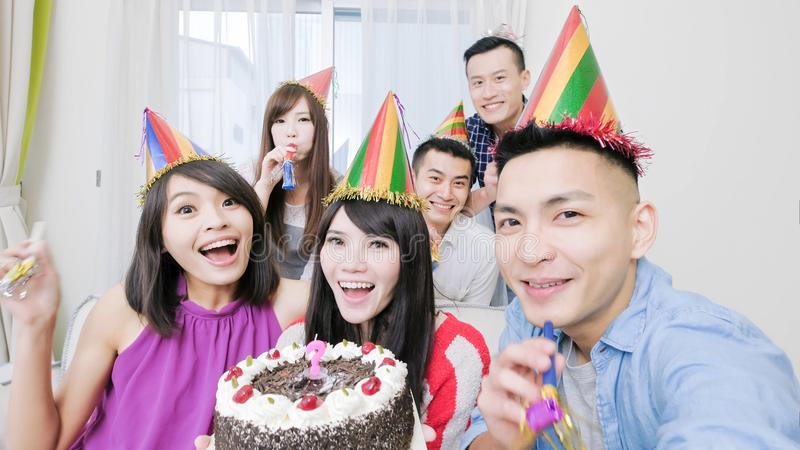 People with birthday party. People smile happily with birthday party in the home stock photo