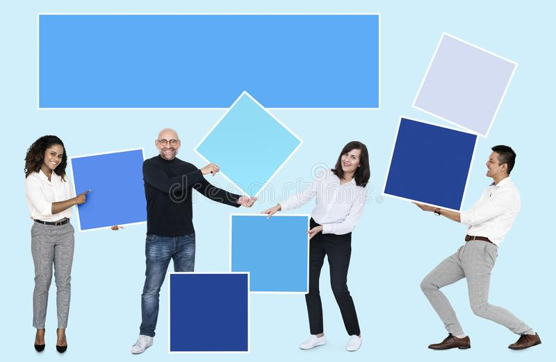 People with blank colorful boxes royalty free stock photos