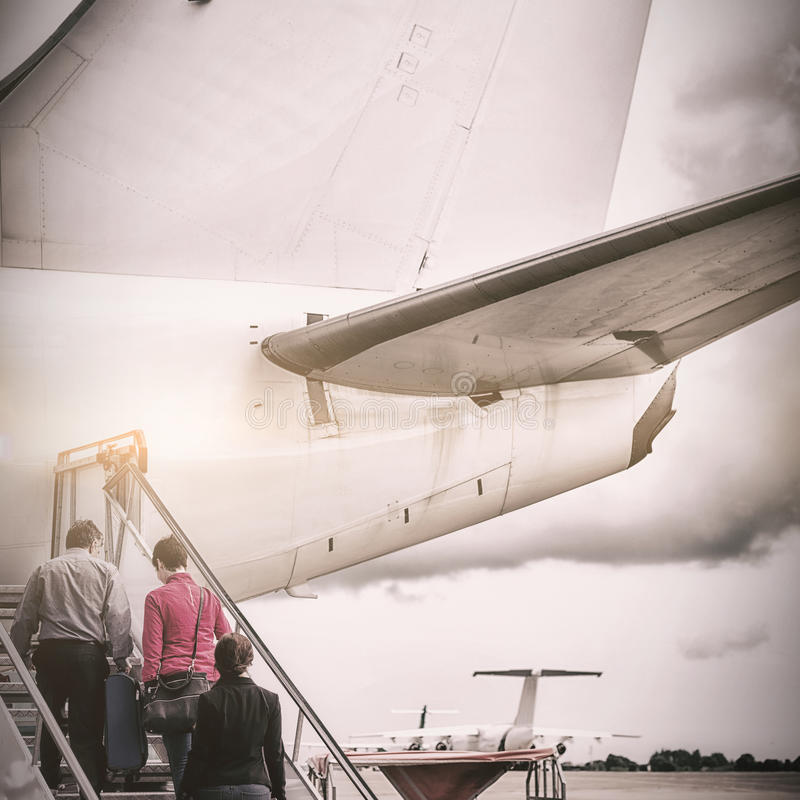 People boarding in airplane stock image