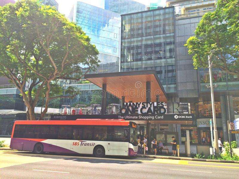 People boarding bus - Orchard Road royalty free stock images