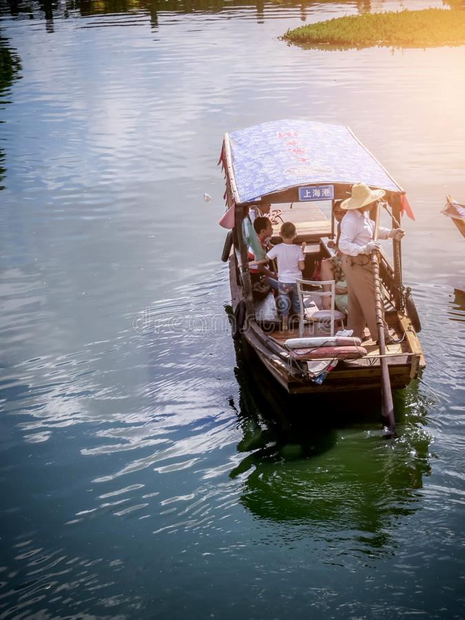 People in a boat on the River in Qibao village in Shangai, China royalty free stock photography