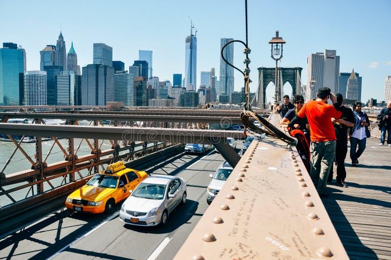 People on the Brooklyn Bridge in Manhattan. stock image