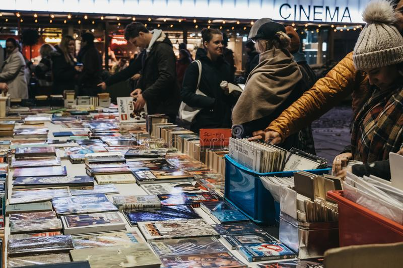 People browsing books at second hand book market in Southbank, London, UK, in the evening stock photos