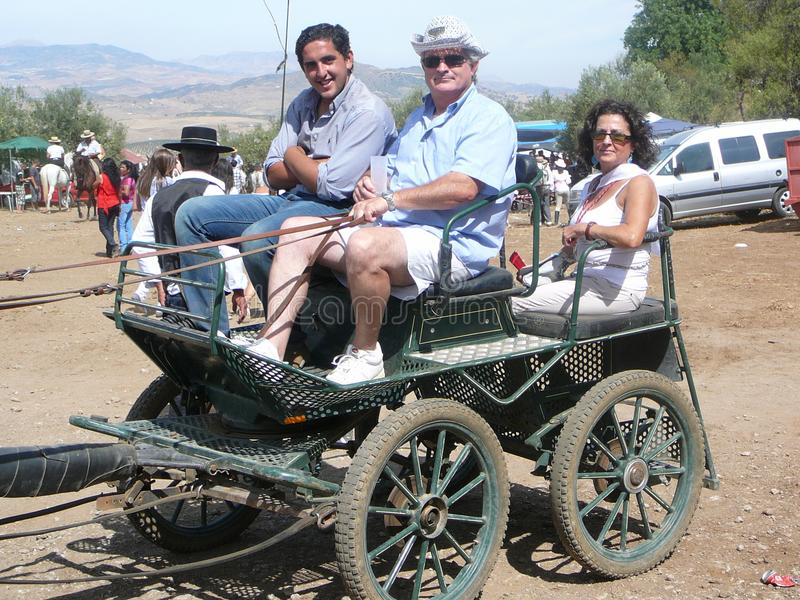 People in buggy at local fiesta. Alora, Spain - September 11, 2011: People in buggy at local fiesta in Andalusia stock photo