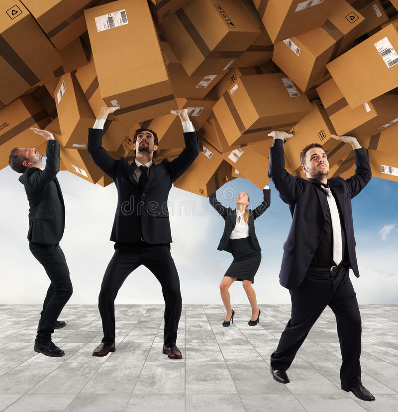 People buried by a stack of cardboard boxes. Concept of internet shopping addiction royalty free stock photo