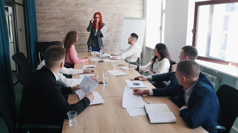 People at the business conference. Annoyed woman chief scolds at her colleagues royalty free stock photo