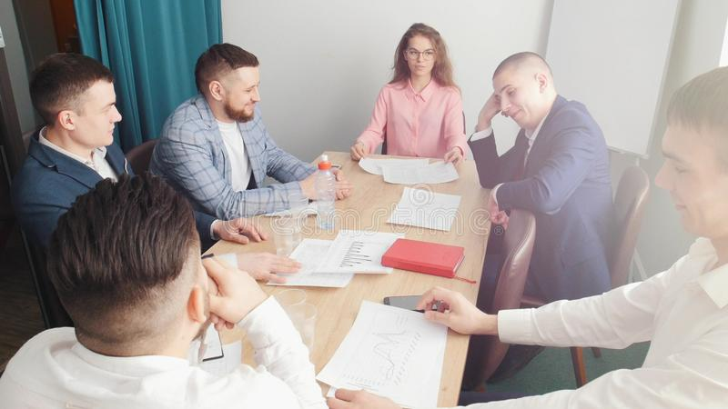 People at the business conference sitting by the table in a small office stock photos