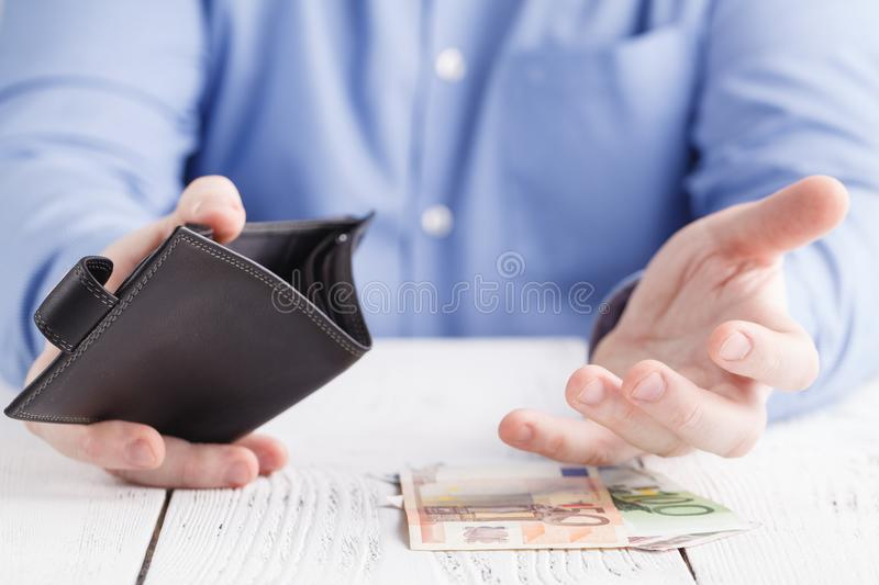 People, business, finances and money concept - close up of businessman hands holding open wallet with euro cash stock photography