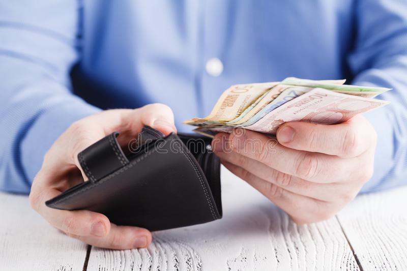 People, business, finances and money concept - close up of businessman hands holding open wallet with euro cash stock photos