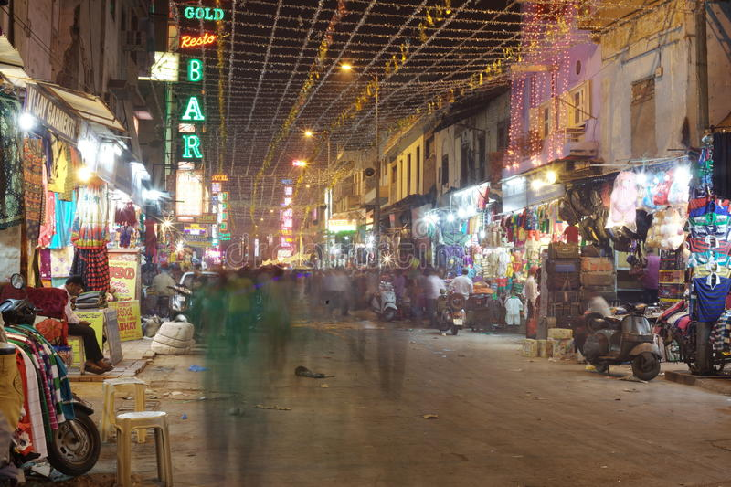People are busy with daily activities on famous Main Bazaar Road royalty free stock image