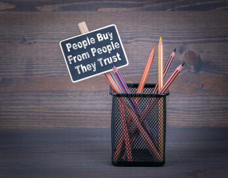 People Buy From People They Trust. A small blackboard chalk and stock photos
