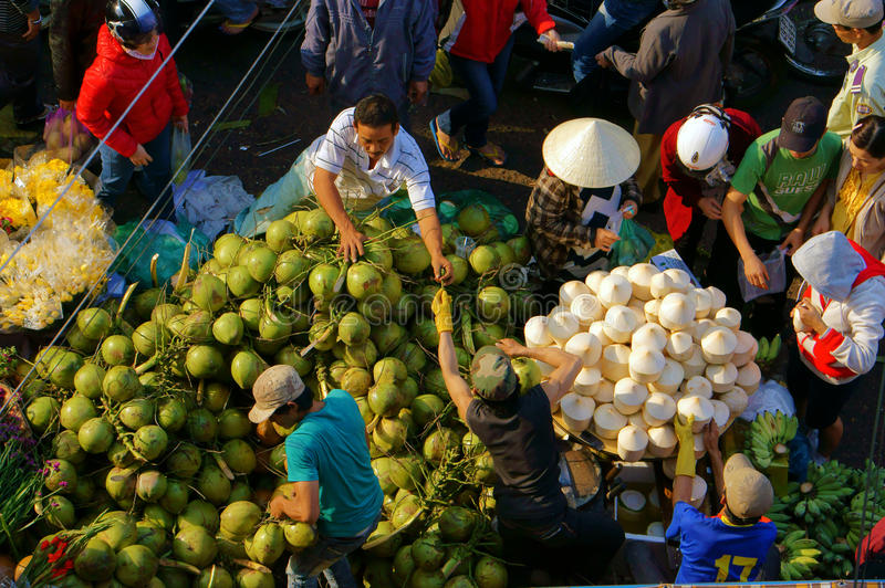 People buy and sell coconut at market.DA LAT, VIET NAM- FEBRUARY 8, 2013 stock images