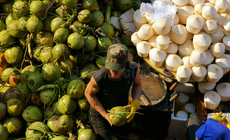 People buy and sell coconut at market. DA LAT, VIET NAM- FEBRUARY 8, 2013 royalty free stock images