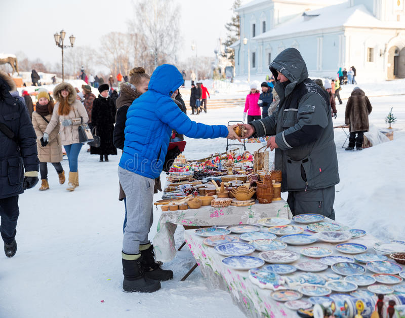 People buy souvenirs. VOLOGDA, RUSSIA - JANUARY 07, 2016: People buy souvenirs Vologda outdoors near Kremlin royalty free stock photos