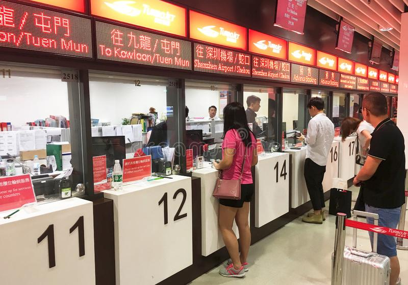 People buy tickets for speedboat trip in Macau. MACAU - SEPTEMBER 2017: People buy tickets at the TurboJet ticket office. Operated by Shun Tak China Travel royalty free stock image