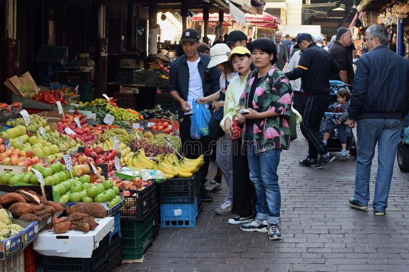 People buying groceries at fruit and vegetable market. ATHENS, GREECE - OCTOBER 2, 2018: People buying groceries at fruit and vegetable market in downtown Athens stock images