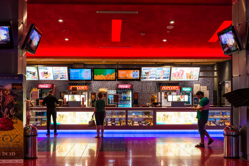 People Buying Popcorn And Soda Drinks. BUCHAREST, ROMANIA - AUGUST 10, 2014: People Buying Popcorn And Soda Drinks At The Cinema Premiere Movies royalty free stock image