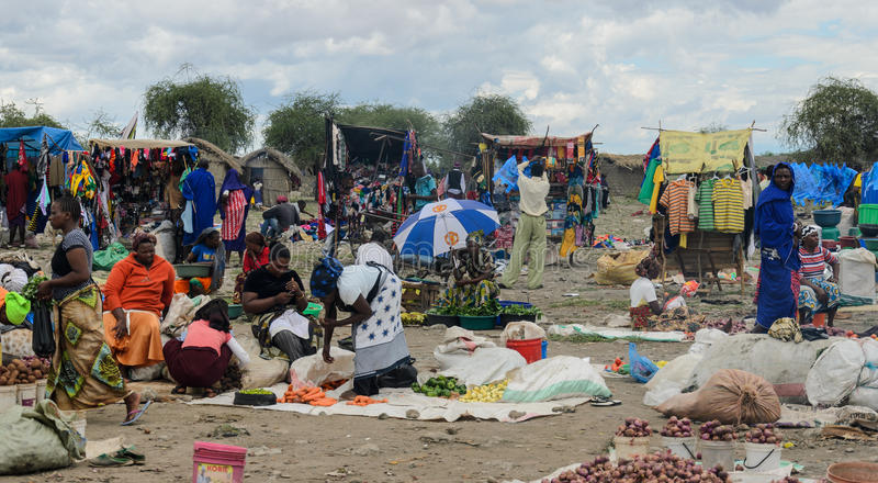 People buying products on the market on march in africa royalty free stock photography