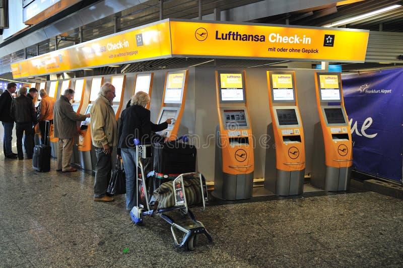 Buying flight tickets in Frankfurt Airport stock image