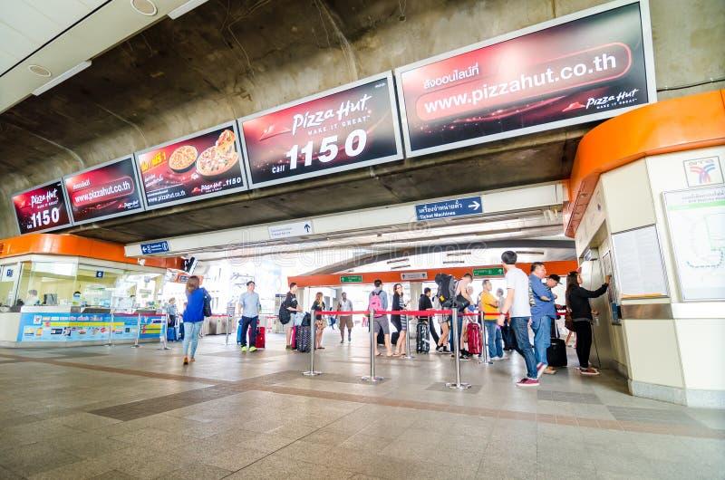 Bangkok, Thailand:People buying tickets at Payath. People buying tickets from automatic ticket machines. BTS sky train at Payathai station in Bangkok, Thailand stock photo