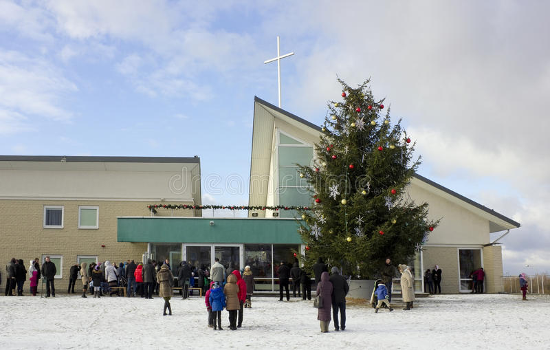 People came to a day Christmas prayer. VILNIUS, LITHUANIA - DECEMBER 25, 2014: People came to a day Christmas prayer to Saint Josef's church, which was founded royalty free stock photography