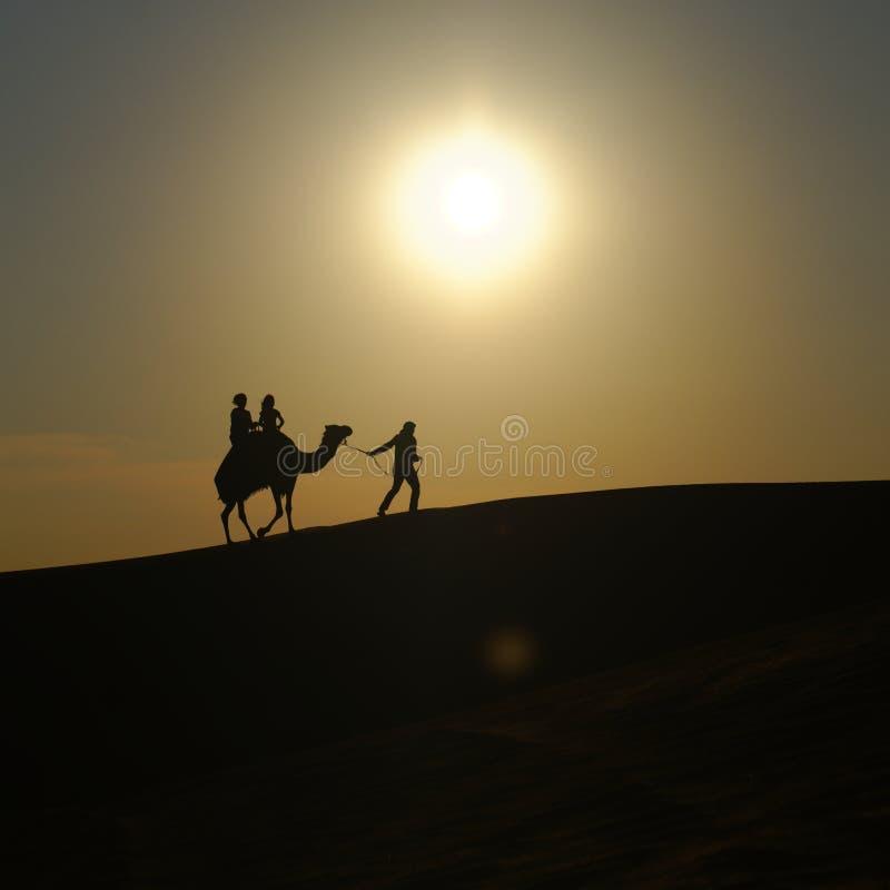 People and Camel on desert. Burj al Khalifa, Dubai, UAE royalty free stock photos