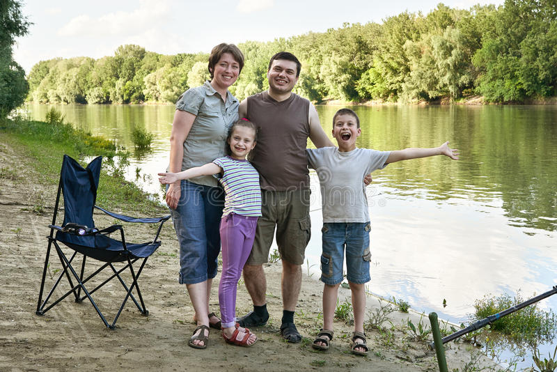 People camping and fishing, family active in nature, fish caught on bait, river and forest, summer season stock photos
