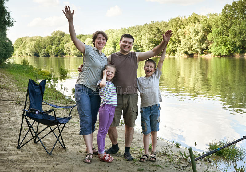 People camping and fishing, family active in nature, fish caught on bait, river and forest, summer season royalty free stock images