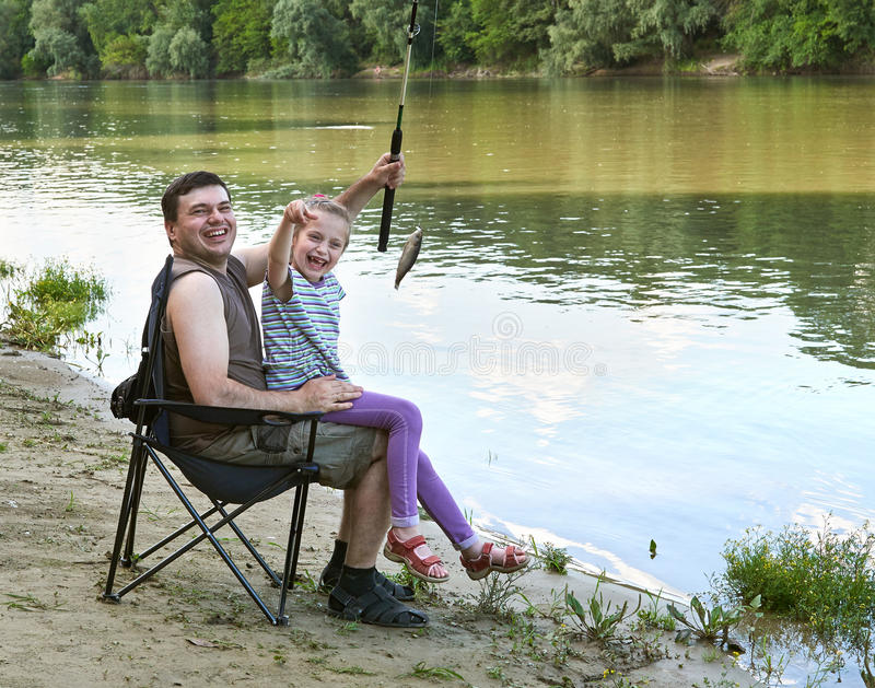 People camping and fishing, family leisure in nature, fish caught on bait, river and forest, summer season royalty free stock images