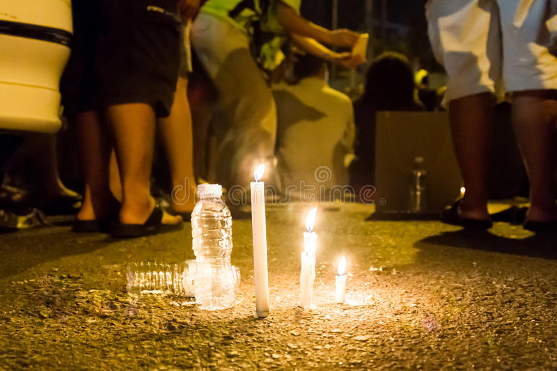 People with candle vigil in darkness seeking hope, worship, pray. Group of people with candle vigil in darkness seeking hope, worship, prayer royalty free stock images