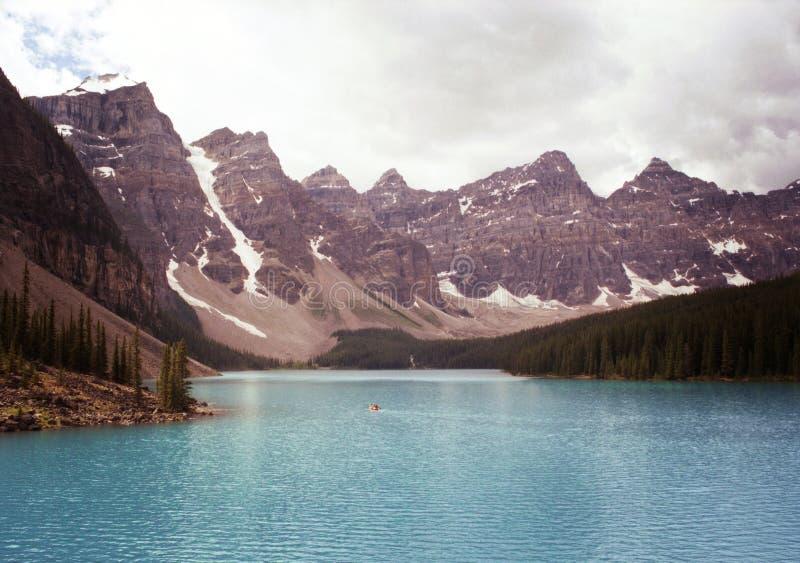 People Canoeing at Lake Moraine Banff Alberta royalty free stock photography