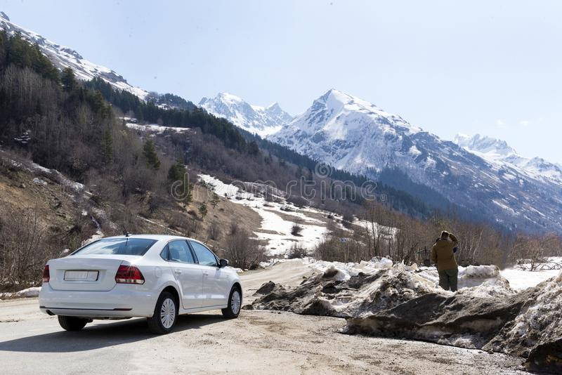 People and car among the mountains of the North Caucasus stock photos