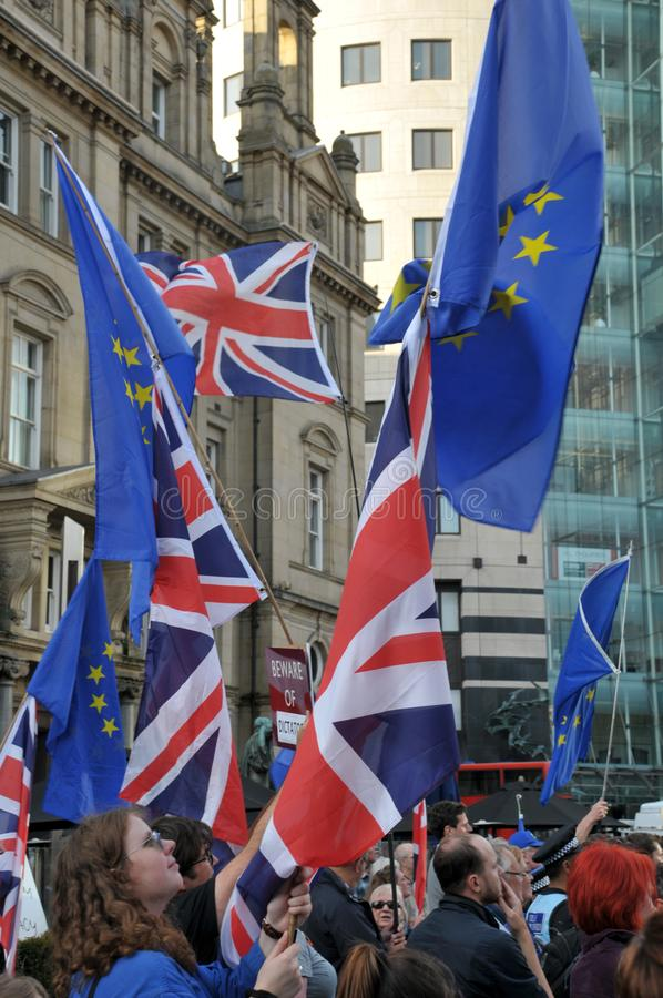 People carrying flags at the leeds for europe anti brexit demonstration. Leeds, west yorkshire, united kingdom - 29 august 2019: people carrying flags at the stock photos