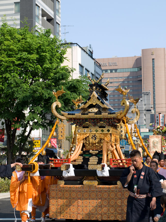 People carrying a portable shrine stock image