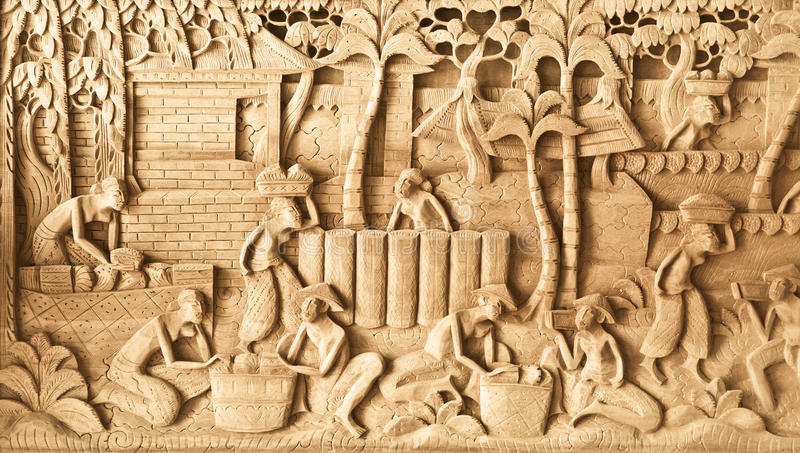 People carved on wood. Pattern of people carved on wood in Bali, Indonesia royalty free stock images