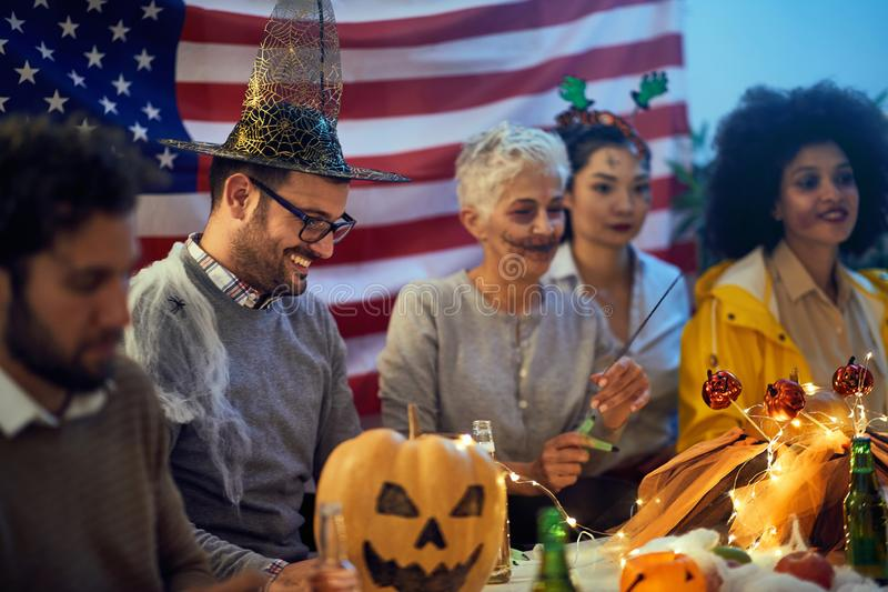 People celebrate Halloween in  creepy costumes stock image