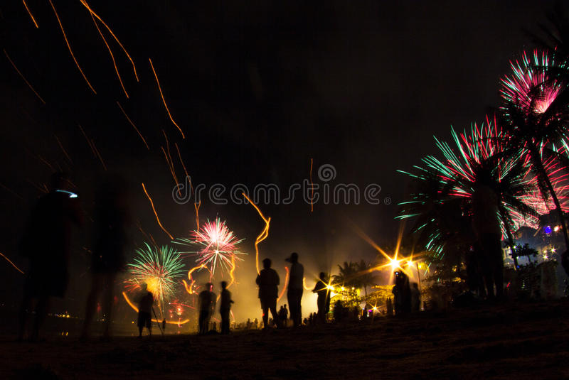 People celebrate holidays on the beach with fireworks stock photo