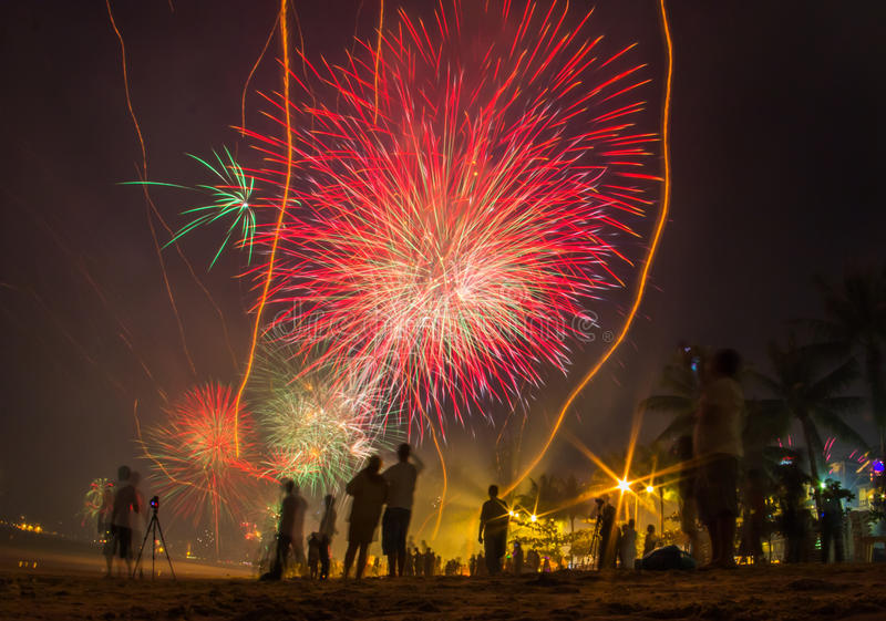 People celebrate New Year Eve`s looking for fireworks stock image